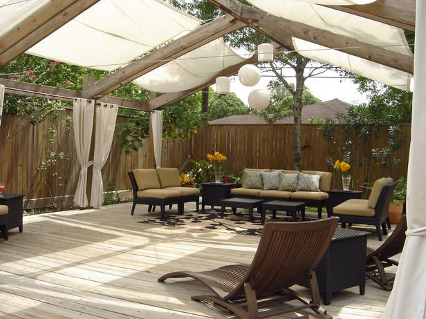 Sailcloth shades this outdoor room from the sun while the draperies help define the space.: Shades, Idea, Covers Patio, Decks, Outdoor Rooms, Outdoor Living, Gardens, Backyard, Outdoor Spaces