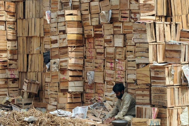 A man made wooden boxes for sale in Lahore, Pakistan, Monday (3/19/12)