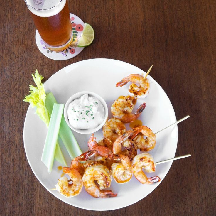 Sure, there are lots of cute Halloween candies and cupcakes you can make to impress your guests, but it's important to serve some savory offerings as well. Check out this Grilled Buffalo Shrimp orange-hued recipes