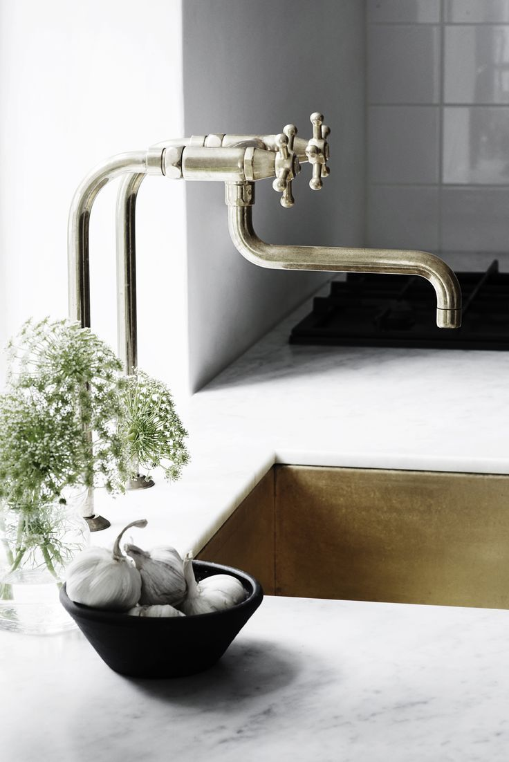 Modern kitchen with some vintage details.  Marble counters with built in metal sink