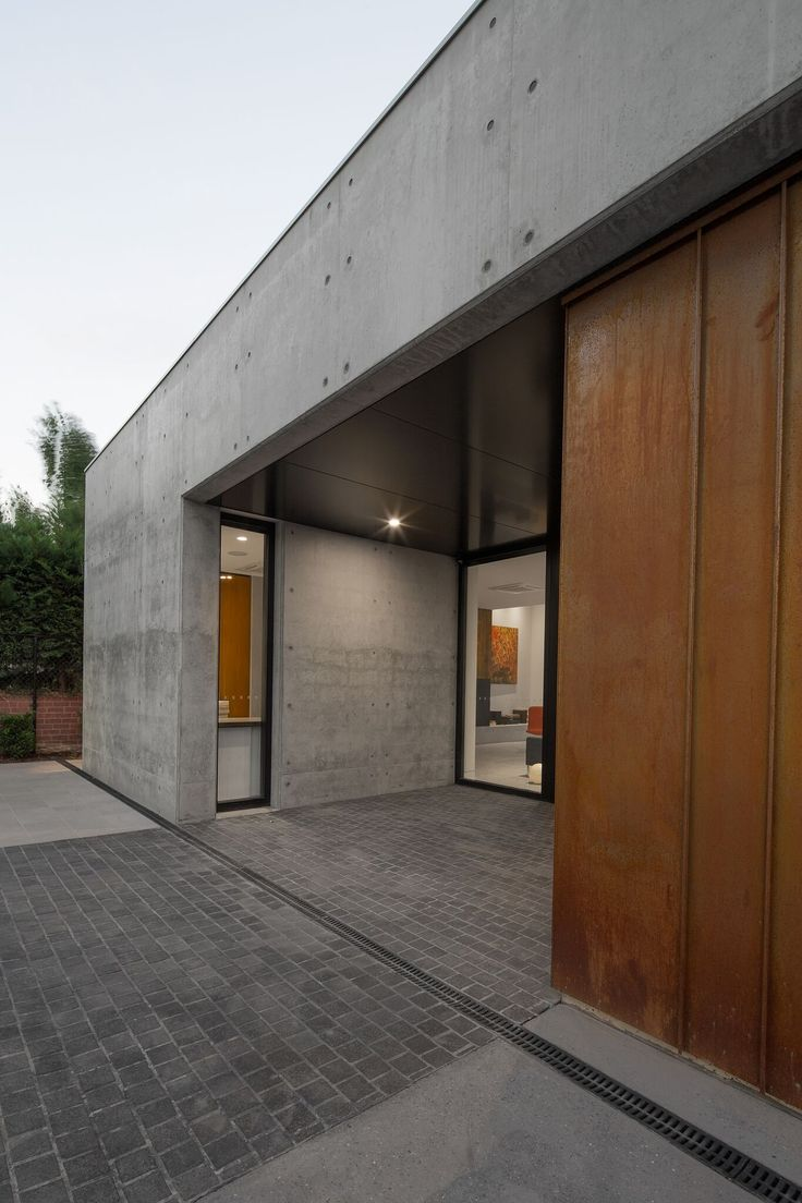 Entry -,corten, concrete and stone paving