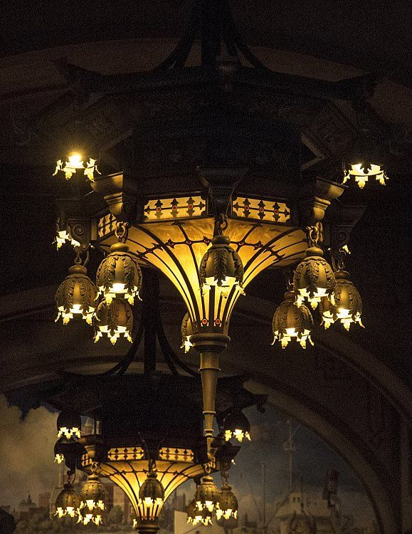 Iron Chandeliers With Dim Lights And Detailed Decorations Owner