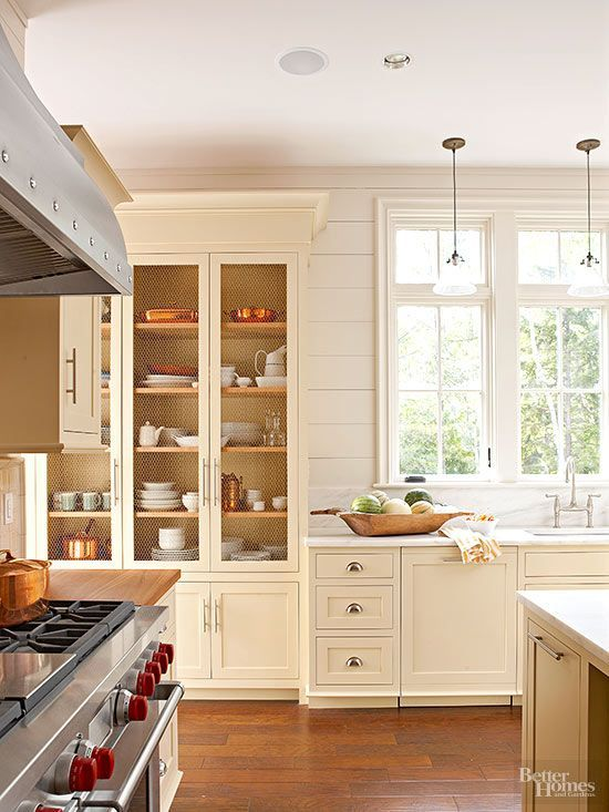 Chicken wire door inserts add texture to traditional cabinet doors and keep this substantial built-in hutch from looking like a solid mass. The subtle door detail gives display storage more personality./