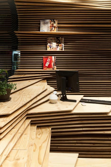 "Gurunavi cafe and office by Kengo Kuma / ""Japanese architect Kengo Kuma has layered wooden boards to create striations inside this workspace and cafe for an online restaurant guide based in Osaka."""