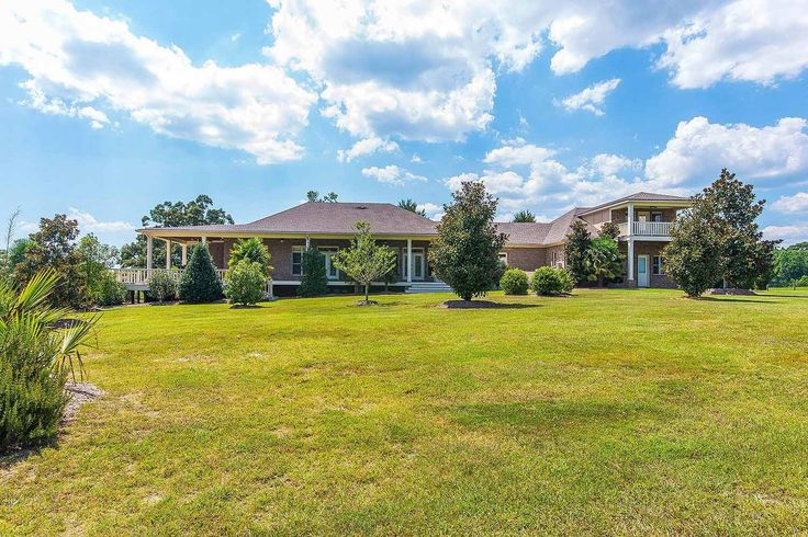 CLICK2TOUR this spacious 6400+SF home on 60+acres outside of Tallassee AL. 2 Living areas, 2 Kitchens, beautifully detailed throughout, huge laundry room. Wrap-around covered porches, open deck, outside half bath, attached 3 car garage plus workshop, detached 2 car garage. Spectacular views of the entire property including 4 stocked ponds. For more details, call/text, Mary McLean- 334-324-2922 with Montgomery Metro Realty. Photos & tour by Sherry Watkins…I Shoot…