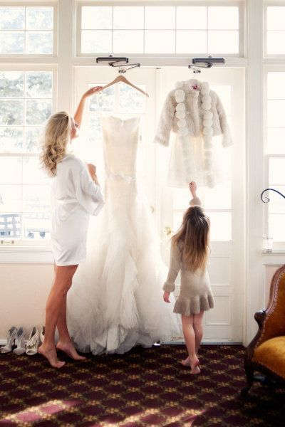 a picture with the wedding dress and flower girl dress / http://www.deerpearlflowers.com/getting-ready-wedding-photography-ideas/3/