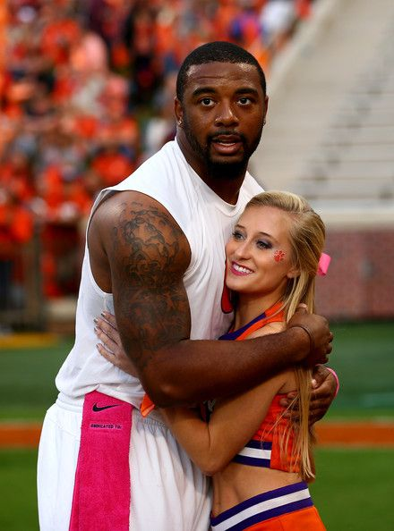 Tajh Boyd Photos - Citadel v Clemson - Zimbio. You don't realize how big he is until you see him next to her!