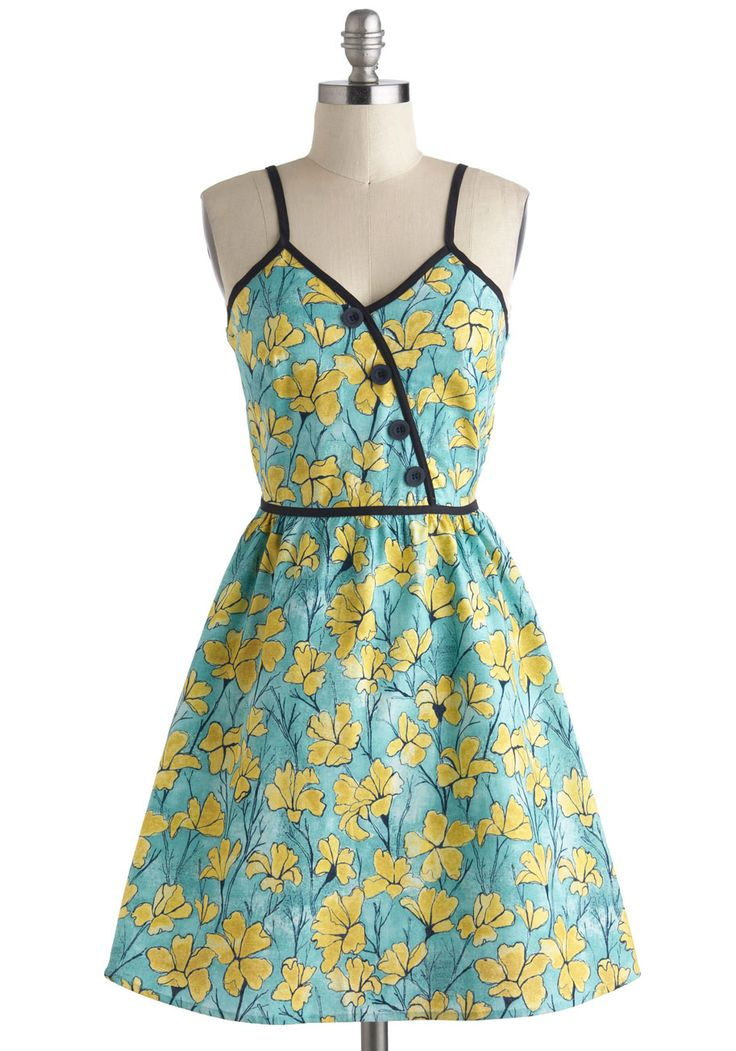 Love the black trim on this floral dress. Blossom Buddies Dress - Floral, Cotton, Mid-length, Blue, Yellow, Black, Buttons, Daytime Party, Fit & Flare, Spaghetti Straps, V Neck, Vintage Inspired, 60s