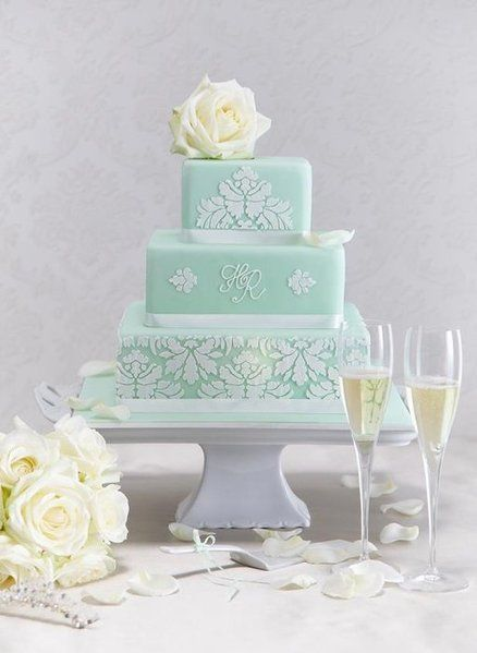Mint green wedding cake. Ok Kayla I'm starting to like the mint green. This is gorgeous!