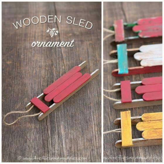 Super cute! Little wood sled ornaments made out of popsicle sticks.