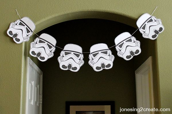 Clone trooper garland makes for a great decoration and target practice for a Star Wars birthday party.