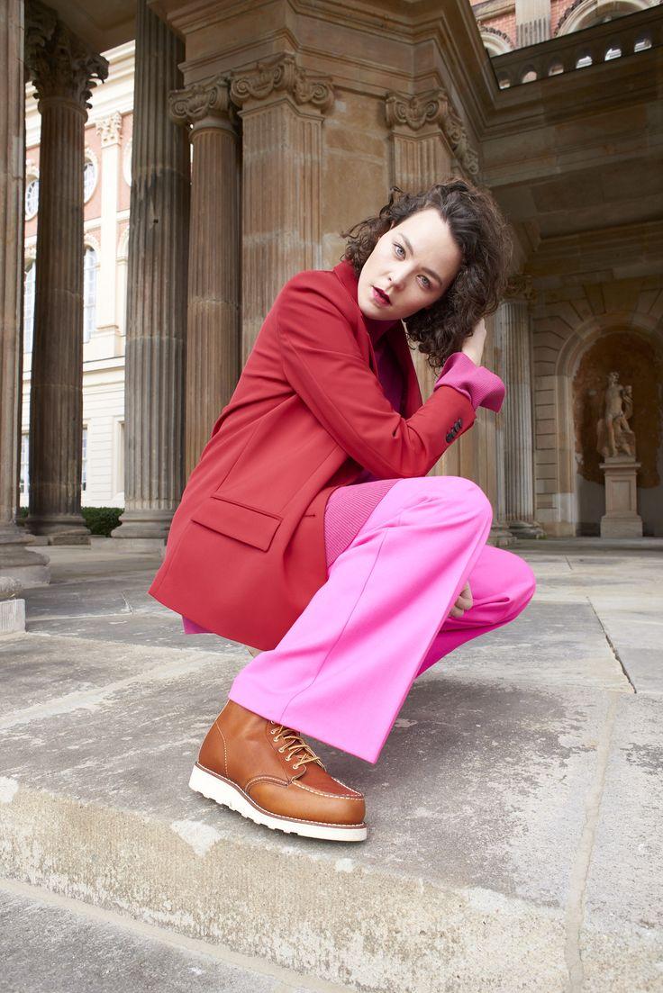 Kiki Albrecht is wearing Red Wing Moc Toe boots, Mango blazer, Malaikaraiss wool paonts & a Tiger Of Sweden sweater