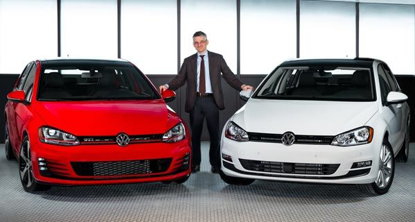 Volkswagen Group of America CEO Michael Horn stands with the 2015 Golf and Golf GTI.