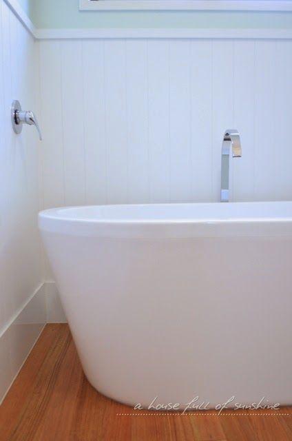 Freestanding white tub against VJ panelling | A house full of sunshine: A beachified bathroom