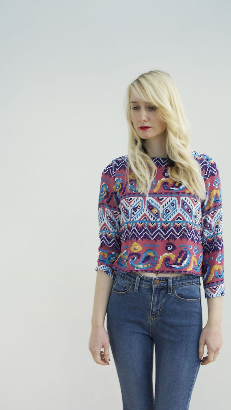 Long 3/4 sleeve crop top with high neck made in aztec soft cotton lawn fabric. Perfect teamed with high waisted jeans. Made to order in the UK. 100% Cotton.