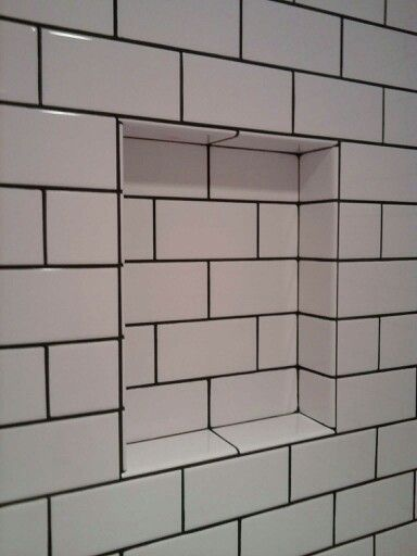 Love the black grout with the white subway tiles. …