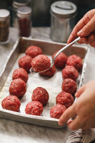 True Italian Baked Meatballs with Sausage and Beef (Polpette di Salsiccia e Manzo al Forno) | Enjoy this authentic Italian recipe from our kitchen to yours. Buon Appetito!
