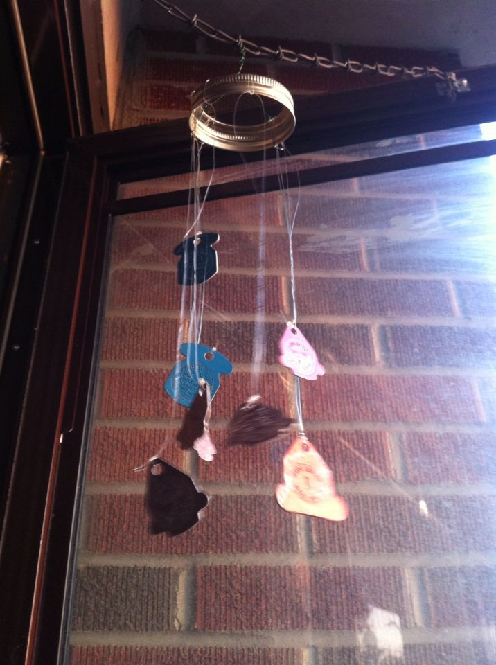 DIY wind chime made from mason jar lid and vintage milk tags