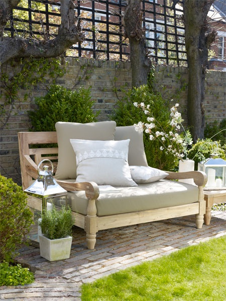 Deep seat, white washed Knotty Alder chair frame, lime washed brick, square lattice work, mute colored pillows