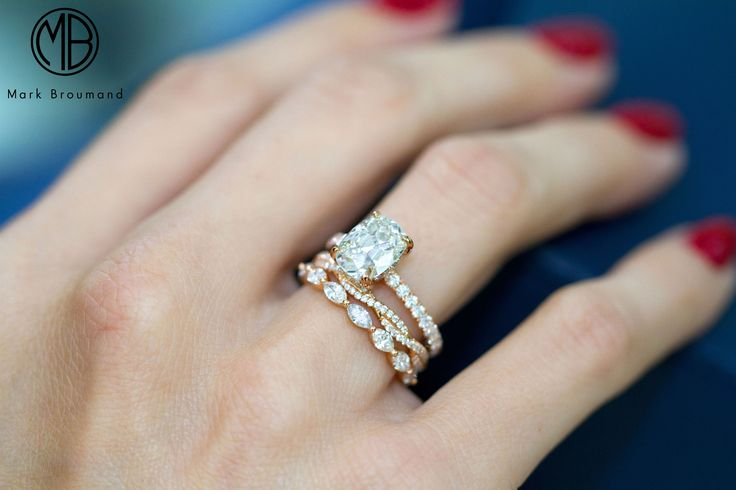 This is one of our most favorite combinations. We love stacking dainty rose gold diamond bands with a beautiful old mine engagement ring.