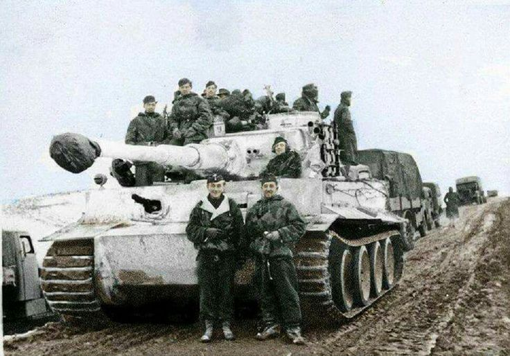 Tank Ace Otto Carius with his Tiger 1 and crew pose for a picture for home.