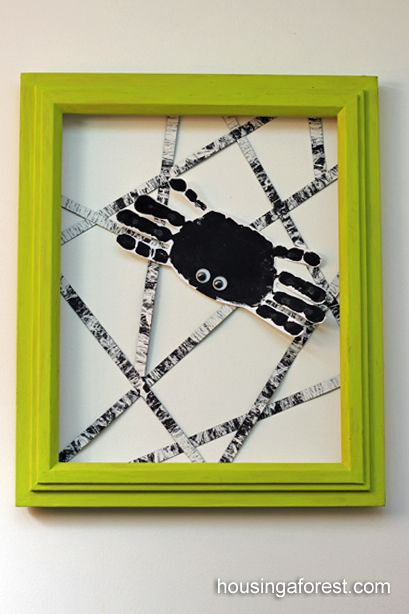 Simple Handprint Spider ~ marble painted spider web and green frame.