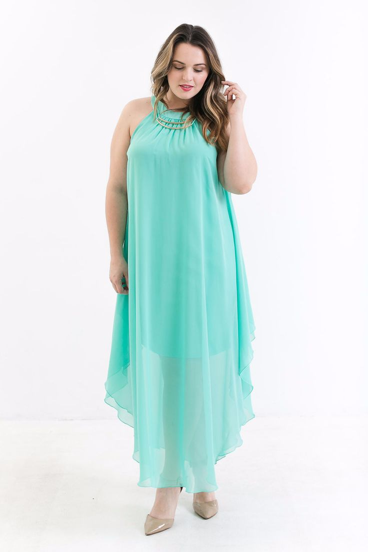 This colorful maxi is sure to turn some heads! The Maldives Mint Maxi Dress features a two piece gold necklace, mint chiffon fabric, hanky hemline, two button closure, flowy cut, and short slip. Add s