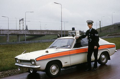 A police sergeant stands beside a classic police vehicle of the era in February 1975. The Ford Capri – in its various guises – was one of the stalwarts of traffic policing for many years. We hope this image will bring back a few memories of bygone police transport. http://www.gmpmuseum.com
