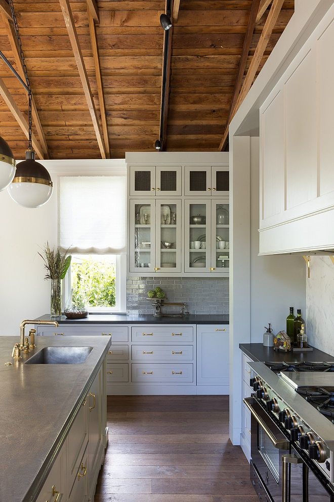Blue grey cabinets, soapstone counter, brass, hood vent and shelves to side to hide the everyday spices and oils-Mill Valley by HSH Interiors | Home Adore