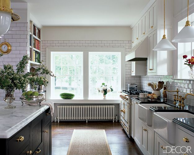 mark badgley & james mischka's kentucky kitchen. love the brass and the dark grout. via elle decor.