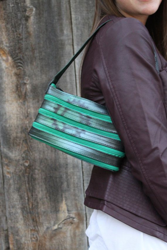 Continuous Bicycle Inner Tube Zippered Hand Bags door HummingWilde, $40.00