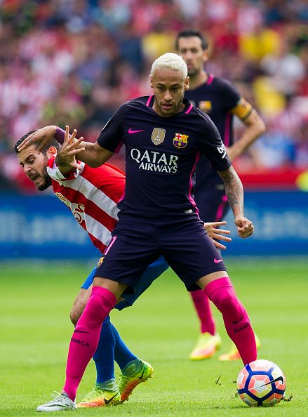 Neymar of FC Barcelona duels for the ball with Victor Rodriguez of Real Sporting de Gijon during the La Liga match between Real Sporting de Gijon and...