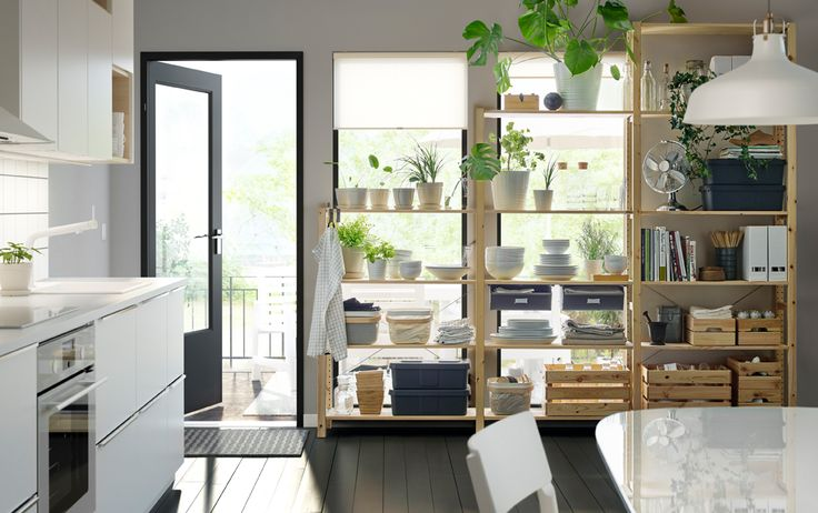 they placed a shelving unit in front of window  could do this on back dining wall