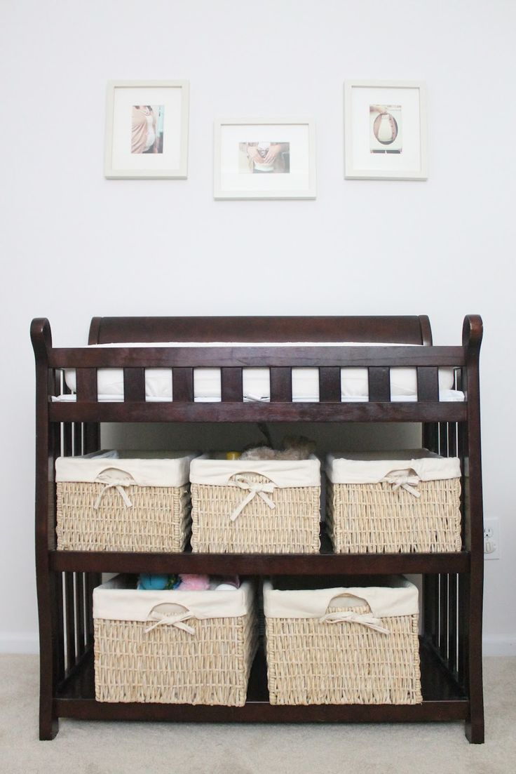 maternity photos make easy decor in this neutral nursery