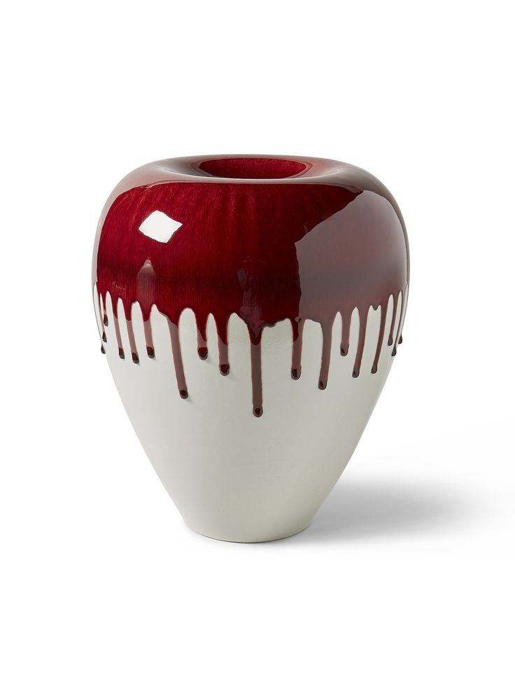 As this deep red glaze bakes in our high-fire kilns, it begins to drip, capturing a moment in time and creating an arresting contrast with the celadon glaze underneath. A study in curves, these glossy