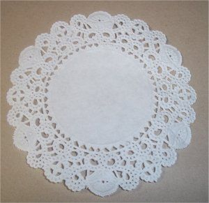 "Paper, Paws, etc.: Doily Dress Folds Tutorial, Step 1: Take a 4"" paper doily...the kind you can buy in packs in the cake decorating section of Michaels, A.C. Moore, etc.  There is a front and back to the doily.  Start with the doily face down."