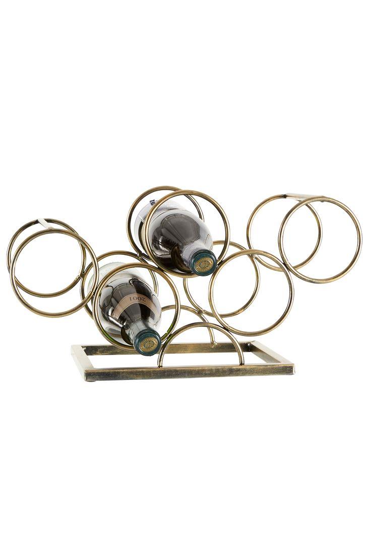 Vinstativ av metall med dekorativt patinert overflate. For 5 flasker. Høyde 21 cm, dybde 20 cm, bredde 41 cm.
