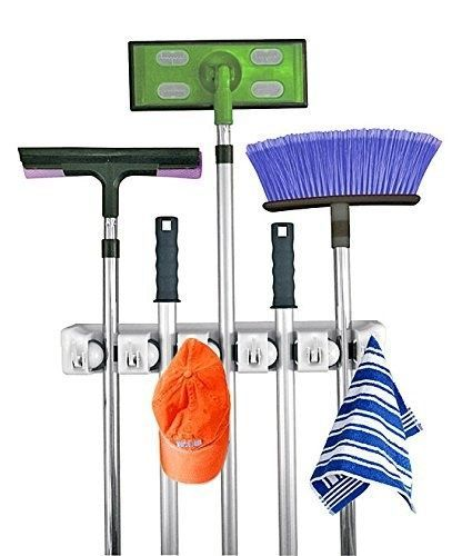 … this wall-mounted mop, broom, and Swiffer holder. | 22 Genius Things Everyone With A Small Apartment Needs To Own