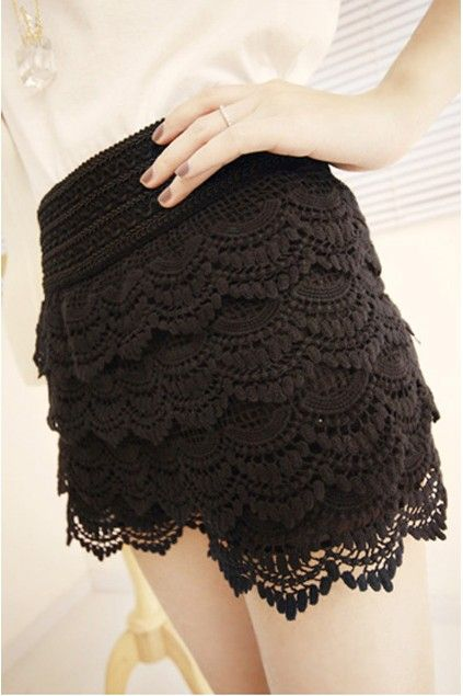 Vintage lace shorts, featuring a fitted high elastic waistband with draped embellishments and lace detail.