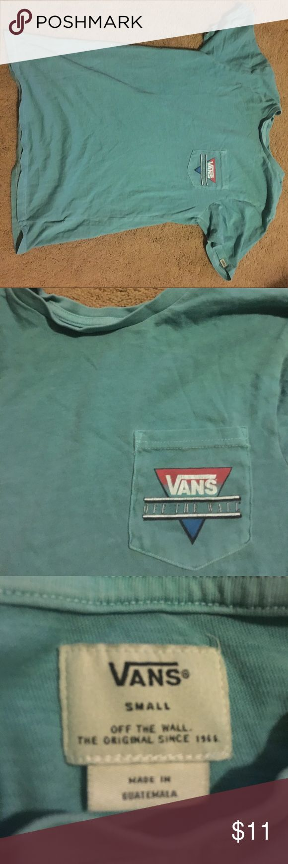 Cyan Vans off the wall tee with pocket adult small This is a cyan, adult small vans t shirt. It has a picket with the vans logo in the front as well as a large logo in the back. It was bought for 22$ and is going for $11 because it was worn once Vans Shirts Tees - Short Sleeve
