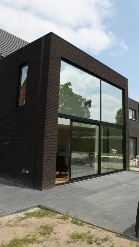 Woningbouw - Bornem - Moderne half open bebouwing - Moderne halfopen woning te Bornem. Gevelsteen: - Nelissen - Zwart Mangaan WF50 - Gelijmd in wildverband. Architect: Van den Bossche architectenbureau.