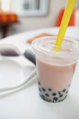 Boba milk tea, also known as bubble tea, is made with tea, milk and tapioca pearls. This treat can be high in sugar and calories. Skipping the pearls or the milk can improve the boba tea nutrition. Tapioca Bubble Tea, Taro Bubble Tea, Bubble Tea Shop, Bubble Milk Tea, Food Trucks, Quick Cooking Tapioca, Fun Cooking, Bubble Tea Flavors, Bubble Tea