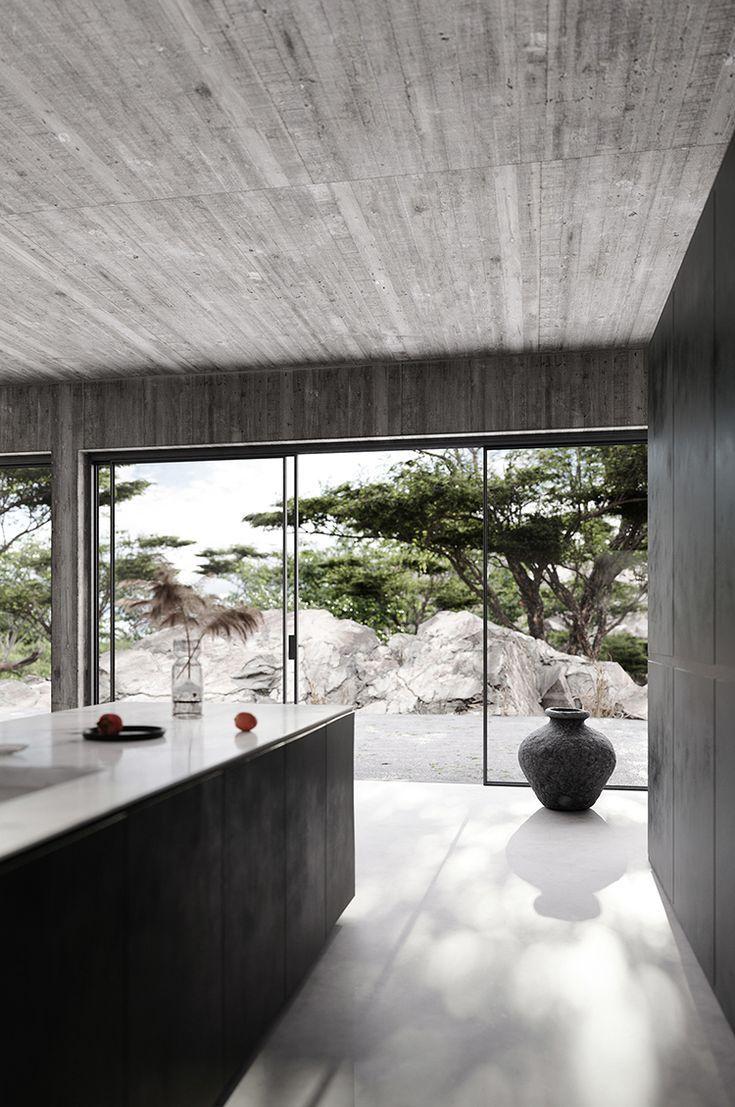 Contemporary Home With Bare Concrete Walls And A Black Kitchen Traditional Interior Design Concrete Interiors Contemporary Interior Design
