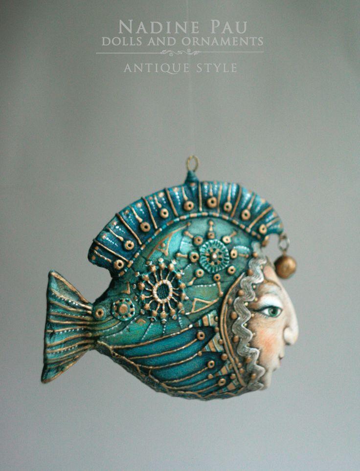"by Nadine Pau. Christmas ornaments.  ""green fish"" Papier mache, oil patina varnish. sold #christmasornaments #nadinepau"