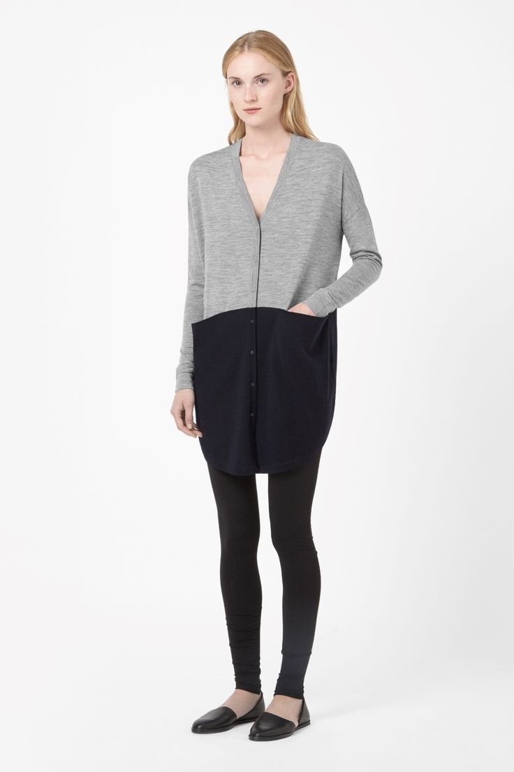 Designed to fall loosely on the body, this long merino wool cardigan has a two-tone block colour design and draped front pockets. With a deep v-neckline and front button fastening, it is finished with narrow ribbed edges and a curved hemline.