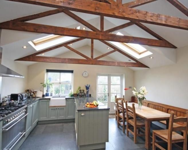 photo of beige duck egg blue white kitchen with beams velux windows