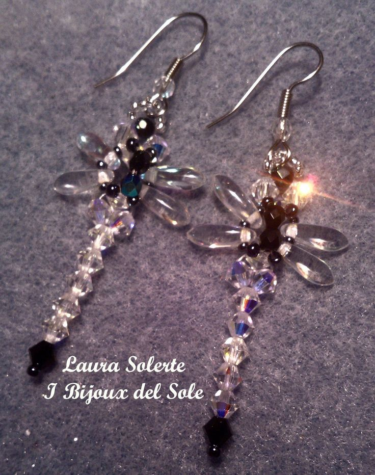Libellule con cristalli Swarovski: ali in daghe di vetro. Dragonfly with Swarovski crystals; glass daggers wings.