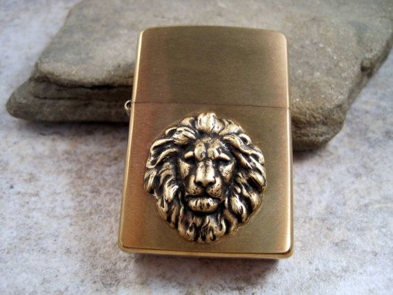 Genuine Brushed Gold Zippo Steampunk Oxidized Brass Lion Head Cigarette Lighter $35 -- or something like it.