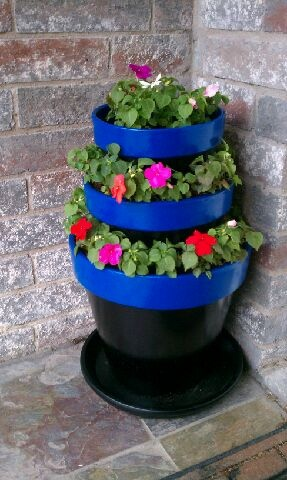 Terra cotta pots painted and stacked. Impatiens.