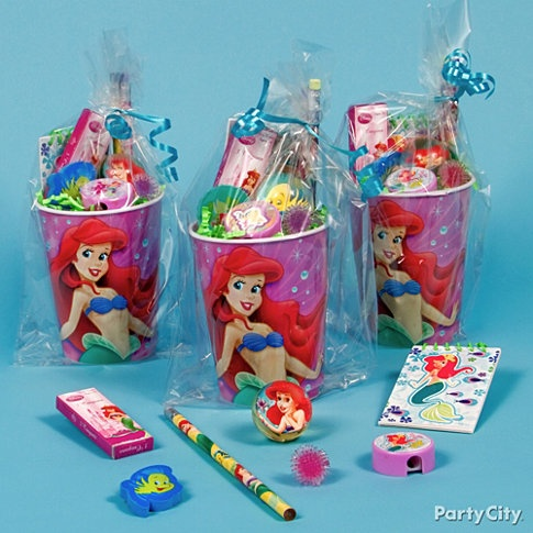 Little Mermaid Theme - Here's a creative way to make reusable Little Mermaid Party Cups into beautiful, fun favors. Fill it with lovely favors like Little Mermaid Crayons, Bounce Balls, Pencils, Sharpeners, Erasers, and Notepads.    We also think Ariel would like these sea-anemone-looking Squishy Rings. Your cup will be picture perfect if you start by lining cups with Lime Green Crinkle Paper Shred. Slip each cup inside a Clear Party Bag and tie it closed with Turquoise Curling Ribbon.
